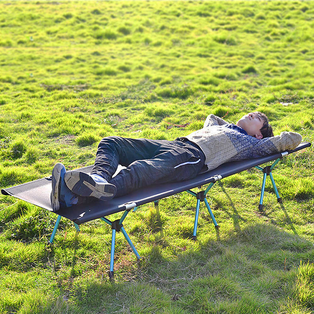Man on camping bed